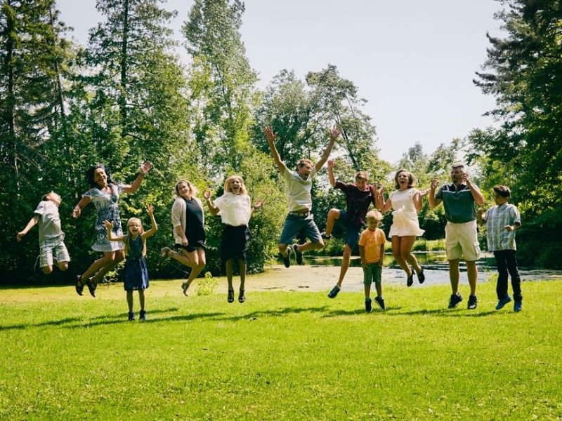 extended family jump shot outdoors